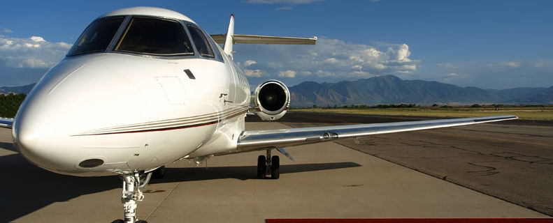 Rolled out red carpet up to a private jet aircraft door